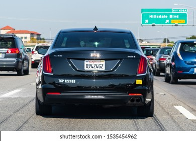 Oct 12, 2019 San Mateo / CA / USA - Cadillac CT6 vehicle driving on a heavy trafficked freeway in San Francisco Bay; Cadillac is a division of the American automobile manufacturer General Motors (GM)