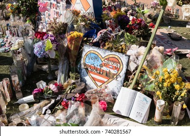 OCT 13 2017 LAS VEGAS NV: Flowers, gifts candles line memorial park at the Welcome to Las Vegas sign by the Mandalay Bay on the Vegas Strip to remember the victims killed in the Las Vegas attack