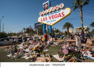 OCT 13 2017 LAS VEGAS NV: Flowers and gifts at the memorial park by the Mandalay Bay on the Vegas Strip at the Welcome to Las Vegas sign to remember victims killed in the Las Vegas attack shooting