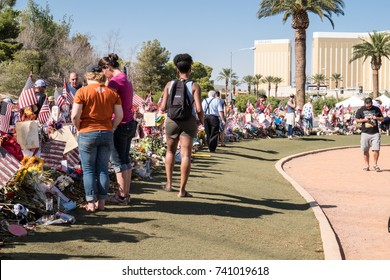 OCT 13 2017 - LAS VEGAS, NV: Visitors pay their respects to the Las Vegas shooting victims on the Las Vegas Strip near the Mandalay Bay at a memorial park