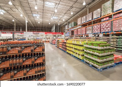 OCT 19, 2018-LEWISVILLE, TX, USA: Wide selection of wine and champagne display in cardboard wine boxes at aisle stacks in Costco Wholesale store. Variety of beverage with price tags