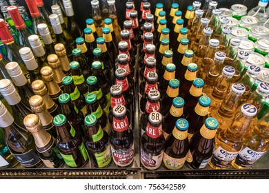 OCT 20 2017 - SAN FRANCISCO, CA: Bottles of soda, root beer, juice and beer for sale in a restaurant display refrigerator cooler