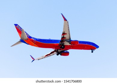 Oct 20, 2019 San Jose / CA / USA - Southwest Airlines aircraft approaching Norman Y. Mineta San Jose International Airport and preparing for landing; blue sky background