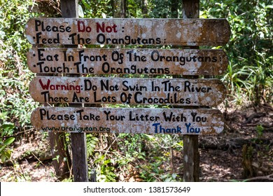 Oct 2017, Tanjung Puting National Park, Borneo, Indonesia: the entry sign of Camp Leakey, the most famous feeding station for Orangutans inside the park, warns tourists about crocodiles in the river