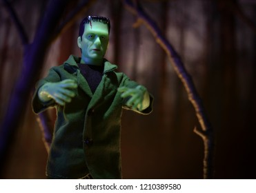 OCT 21, 2018: MEGO Corp Frankenstein Monster action figure walking through a haunted forest.