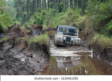 Oct 22, 2017. Bandung, West Java, Indonesia. Old Classic 4x4 Landrover Series Offroading on Water at Lembang, West Java, Indonesia