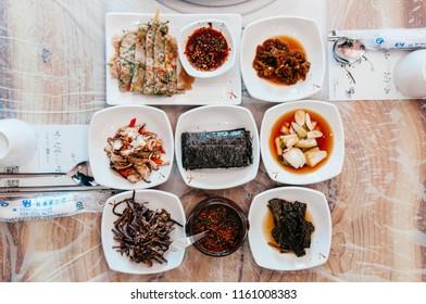 OCT 23, 2013 Gangwon, South Korea - Buchimgae Pajeon Korean pancake and Various kind of Kimchi side dishes. Top view shot