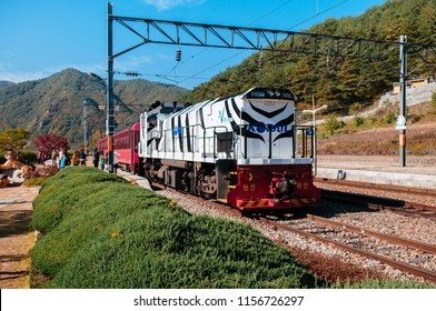 OCT 24, 2013 Gangwon-do, South Korea - V-Train sightseeing train run along stream and valley of famous tourist train route for autumn & winter between Buncheon - Cheoram stations.