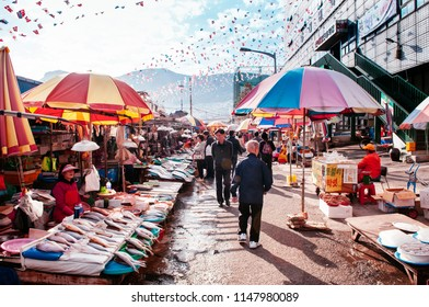 OCT 25, 2013 Busan, South Korea - Various fresh fishes and colourful umbrellas at Jagalchi seafood market, famous tourist attraction
