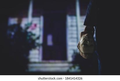 OCT 25 2020: Halloween slasher Michael Myers holding the boogeyman mask  - Neca action figure