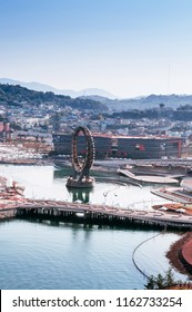 OCT 26, 2013 Yeosu, South Korea - Yeosu expo port ferris wheel with cityscape in background