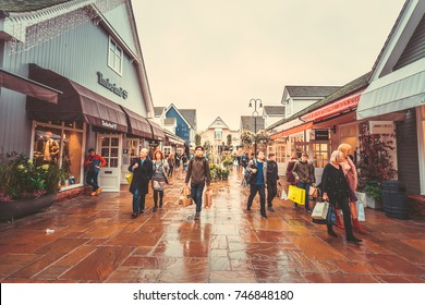 Oct 26,2017 - Bicester Village, London : Inner view of Bicester Village outlet at a rainy day