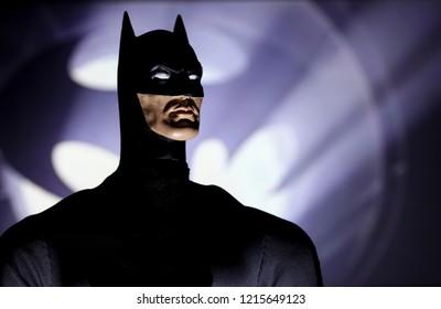 OCT 27 2018:  Portrait of Batman with the Bat Signal, Gotham City - DC Comics - Mego action figure