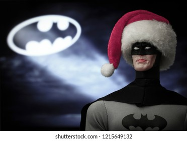 OCT 27 2018:  Portrait of Batman wearing a Santa Claus hat with the Bat Signal, Gotham City - DC Comics - Mego action figure