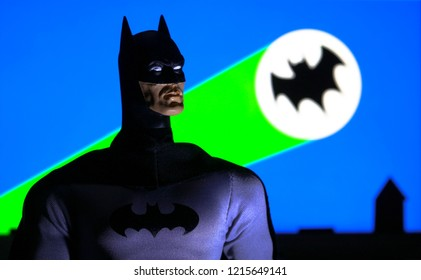 OCT 27 2018:  Portrait of Batman with the Bat Signal from the 1960s television series background of Gotham City - DC Comics - Mego action figure
