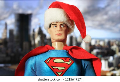 OCT 27 2018:  Portrait of Superman wearing Santa Claus hat with Metropolis in the distance - DC Comics - Mego action figure