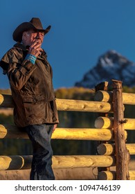 OCT 4, 2017, RIDGWAY COLORADO - Cowboy, Howard Linscott looks out over historic Last Dollar Ranch on Hastings Mesa, SW Colorado, San Juan Mountains
