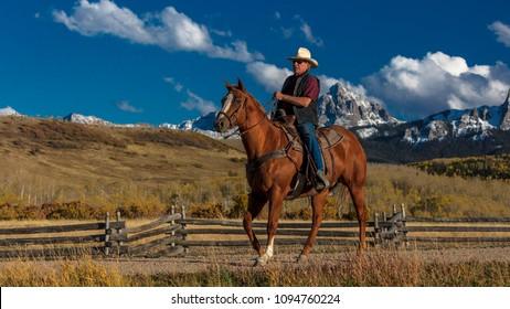 OCT 4, 2017, RIDGWAY COLORADO - Cowboy rides across historic Last Dollar Ranch on Hastings Mesa, SW Colorado, San Juan Mountains