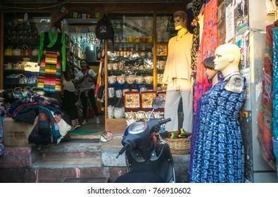 Oct2017,Dharamsala, India, Himalayas, a Tibetan souvenir shop front is illuminated by the setting sun