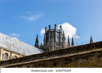 The Octagon Lantern Tower on Ely Cathedral as seen above a wall.