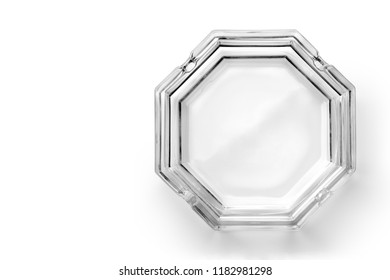 Octagonal glass ashtray isolated on white background. Top view.
