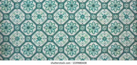 Octagonal patterned portugese tiles texture in green with floral, geometric and spot motifs