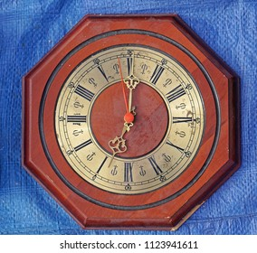 Octagonal wall clock with wood and brass