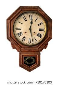 Octagonal wooden wall clock; vintage pendulum clock, isolated on white ground