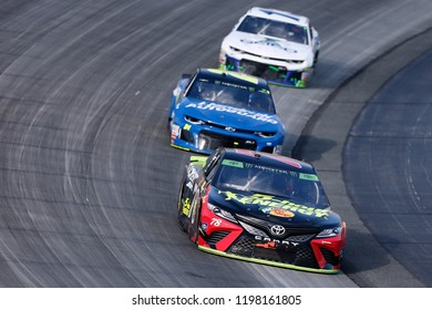 October 07, 2018 - Dover, Delaware, USA: Martin Truex, Jr (78) races through the field off turn two at  the Gander Outdoors 400 at Dover International Speedway in Dover, Delaware.