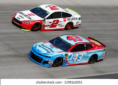 October 07, 2018 - Dover, Delaware, USA: Darrell Wallace, Jr (43) and Brad Keselowski (2) battle for position during the Gander Outdoors 400 at Dover International Speedway in Dover, Delaware.