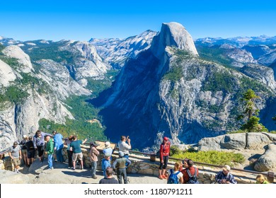 October, 09, 2014 - California, USA - Tourists enjoy a sunny day to visit the Yosemite National Park with Half Dome in the background from Glacier Point.