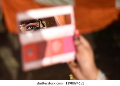 October 09,2018-Uttar Pradesh/India, Allahabad: An Artist looks in mirror during being dressed up as Goddess Sita before performing Ramleela Drama during Navratri Festival Celebration in Allahabad.