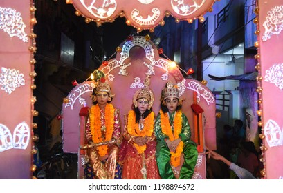 October 09,2018-Uttar Pradesh/India, Allahabad: Artist dressed as lord Rama, his brother Laxman and Goddess Sita take part in Ram Barat Procession during Navratri Festival Celebration in Allahabad.