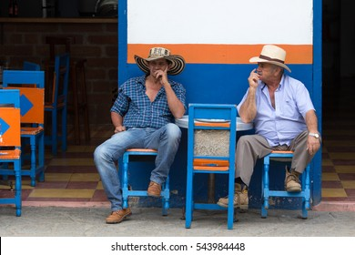 October 1, 2016 El Jardin, Colombia: men relaxing in front of coffee house in the center of the small colonial town