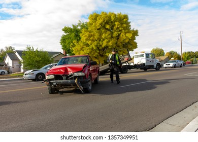 OCTOBER 10 2018 - NAMPA, IDAHO: Driver in red truck rear ends a white car while they are parked at a red light