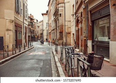 October 10, 2019 Toulouse city in France, the street of the old town with parked bicycles.