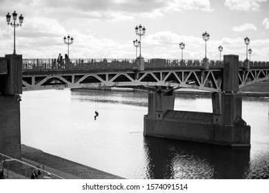 October 10, 2019 Toulouse city in France, a bridge with the installation of a girl on a swing