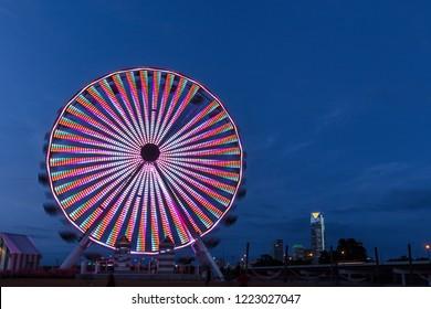 OCTOBER 11, 2018 - Oklahoma City, USA at dusk - we see ferris wheel and Oklahoma City Skyline, Oklahoma City, Oklahoma