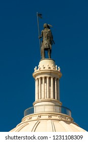 OCTOBER 11, 2018 Oklahoma City USA - A statue created by Enoch Kelly Haney sits atop the Oklahoma State Capitol, Oklahoma City OK