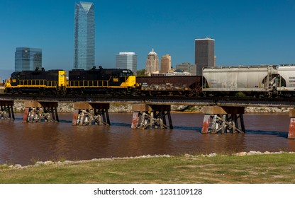 OCTOBER 11, 2018 - Oklahoma City, USA - Train crossing with Oklahoma City Skyline, Oklahoma City, Oklahoma in background