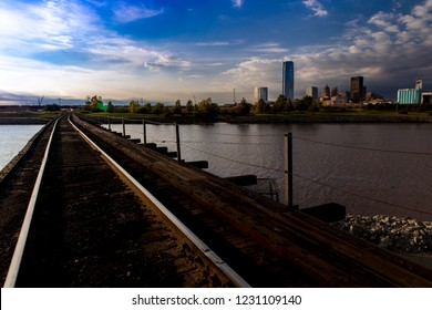 OCTOBER 11, 2018 - Oklahoma City, USA - we see railroad tracks reflection and Oklahoma City Skyline, Oklahoma City, Oklahoma