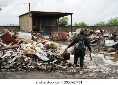 October 11, 2021 Bani, Dominican Republic. Dramatic image of a junkyard recycling plant in a coastal city with Haitian workers going through the piles.