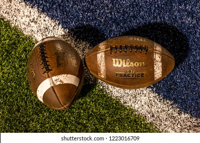 OCTOBER 12, 2018, PARIS TEXAS, USA - two footballs on field, Paris Texas Wildcats defeat Celina, Bobcats 54-7 in High School Division 4 Football Game