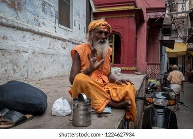 October 12,2017. Portrait of Shaiva sadhu (holy man) with blessing hand in Varanasi, Utter Pradesh,India.