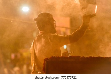 October 12,2017. Varanasi,Uttar Pradesh,India. Evening Aarti puja celebration in Ganges river performed by a young priest . Selective focus is used.