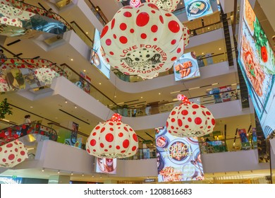 October 13 , 2018 - Bangkok, Thailand :Models of pumpkins by Kusama Yayoi hang from the ceiling of Central World Department Store .