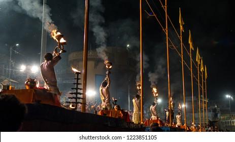 October 13,2017. Ganga aarti puja ceremony performed by young priests at Dashashwamedh  Ghat Varanasi,Utter Pradesh, India. Selective focus is used.