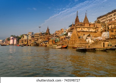 October 13,2017. Varanasi, Uttar Pradesh, India. A view from River Ganges of Old Historical Varanasi city with weathered buildings at the time of Sunrise.