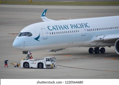 October 13,2018: Chubu Centrair airport -Nagoya: Cathay plane all new a350-900 airbus is pushing back for take off