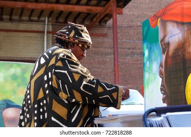 October 14, 2012 - Philadelphia, PA, USA:  A mature African-American woman shops for photographs and prints at an outdoor African-American Art Expo in Philadelphia, Pennsylvania.